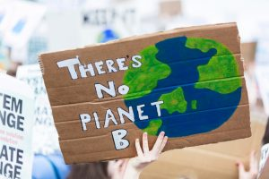 People with banners protest as part of a climate change march