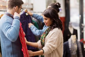 Sale,,Shopping,,Fashion,And,People,Concept,-,Couple,Choosing,Clothes